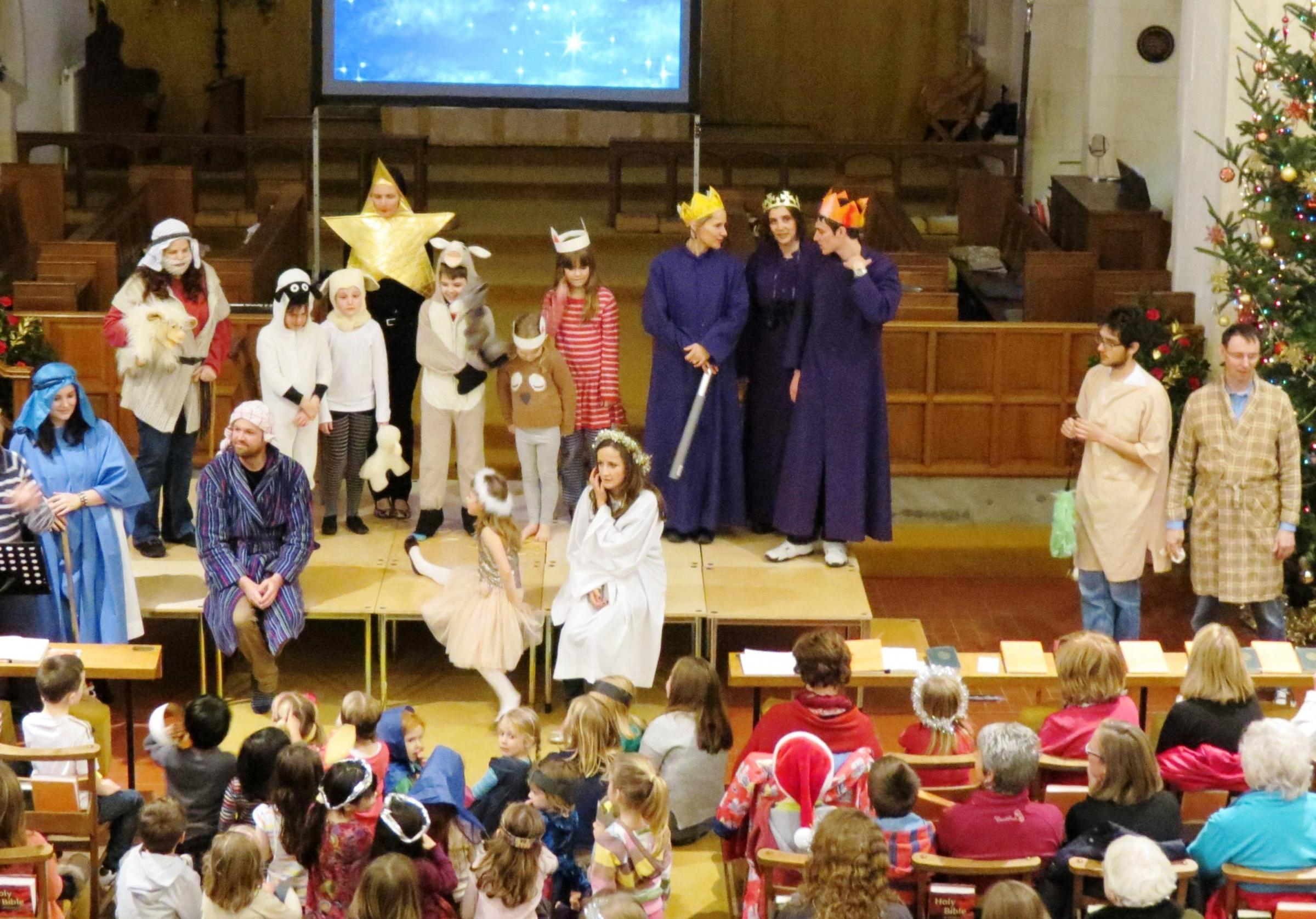 MESSAGE: Families enjoying the Crib Service at All Saints Church (3272722)