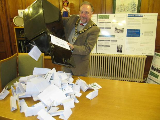 Penarth Times: VOTING CLOSES: Penarth Town Mayor Neil Thomas empties the ballot box that was at the library (3418755)