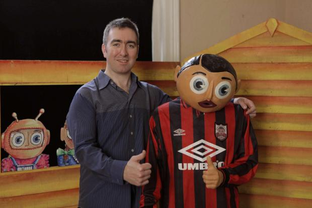 FILMMAKER: Director Steve Sullivan with the iconic Frank Sidebottom paper mache head