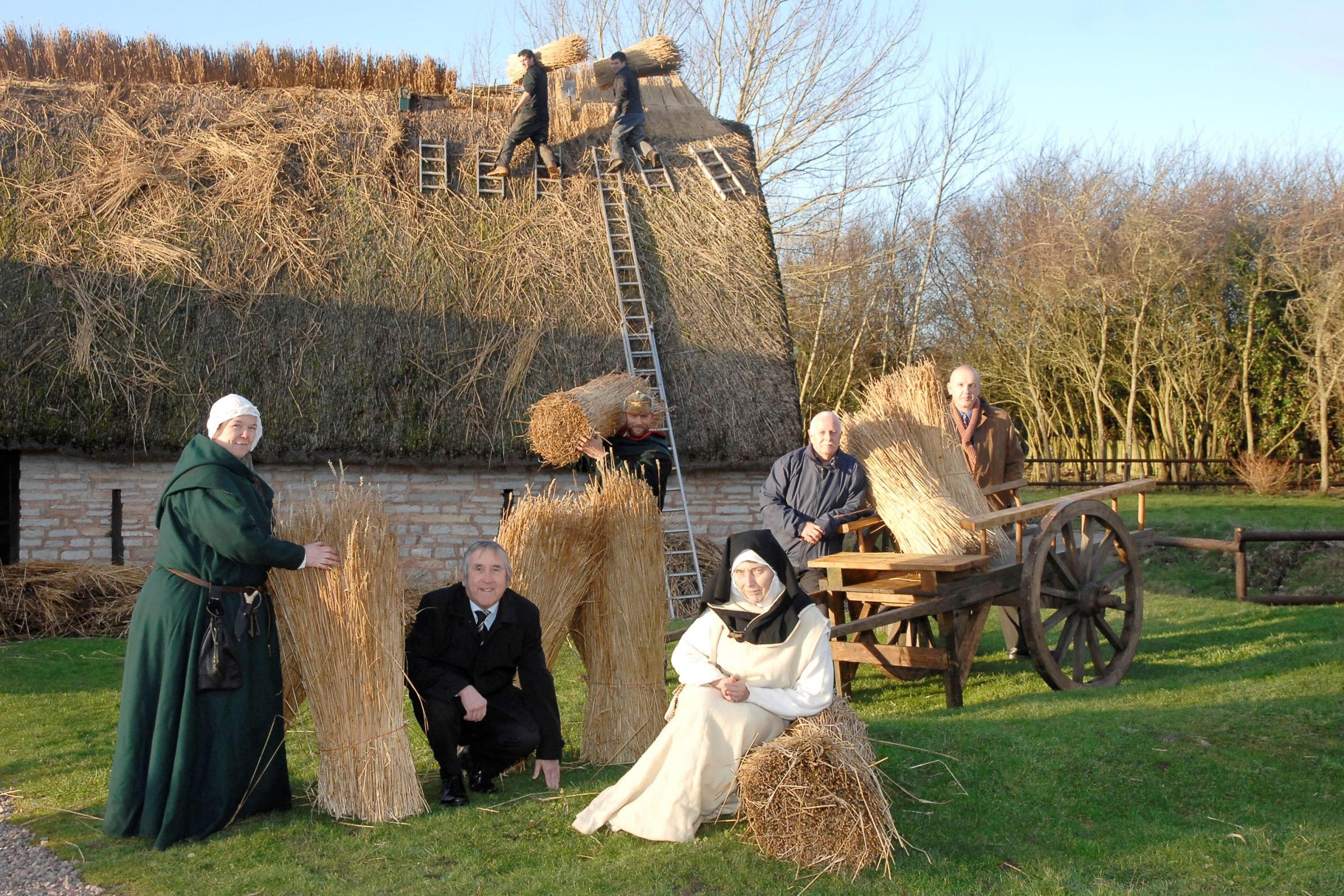 THATCHING: Repair work at Cosmeston Medieval Villiage