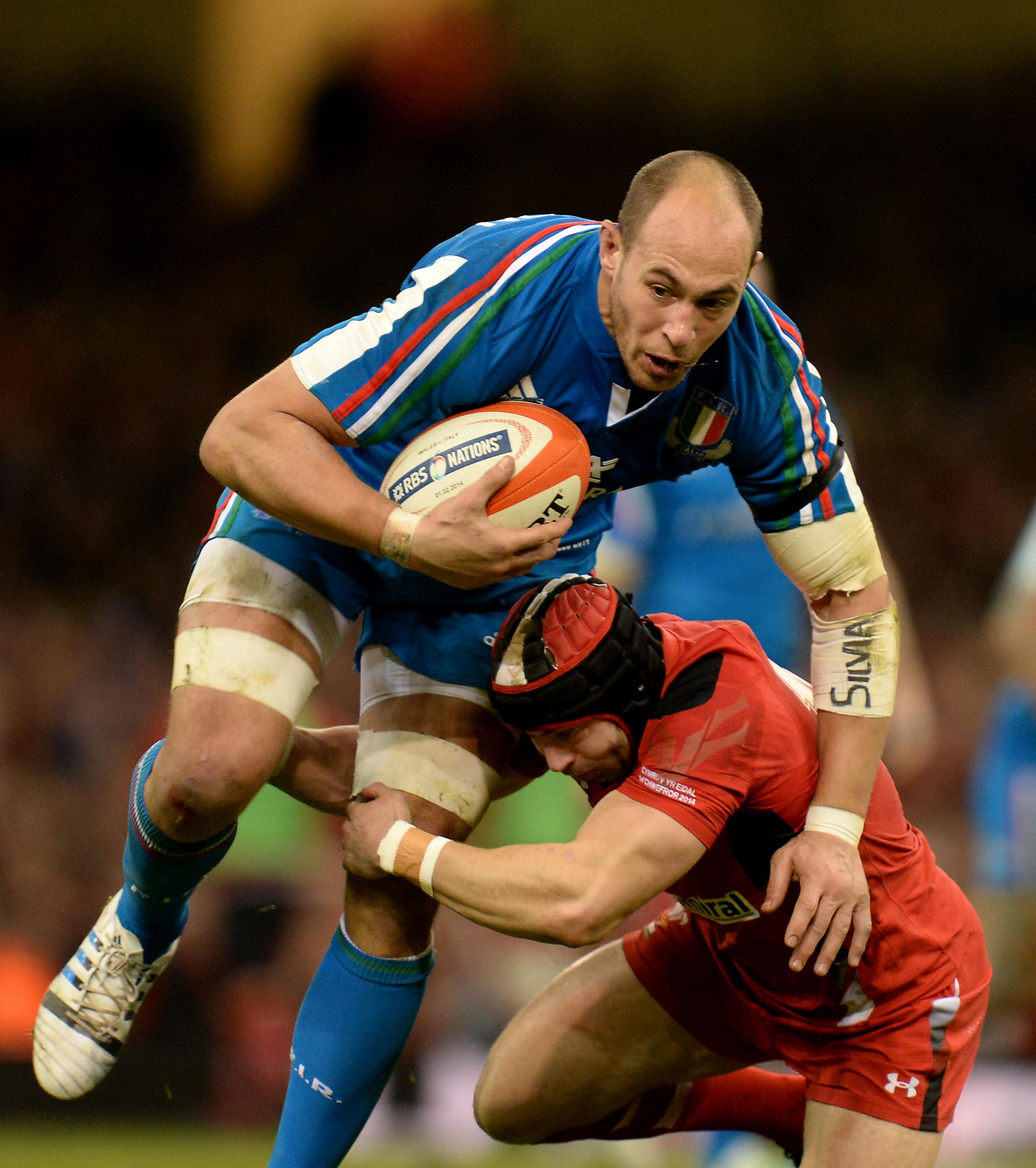 Italy's Sergio Parisse is tackled by Wales' Leigh Halfpenny (right) during the RBS 6 Nations match at the Millennium Stadium, Cardiff. PRESS ASSOCIATION Photo. Picture date: Saturday February 1, 2014. See PA story RUGBYU Wales. Photo credit should