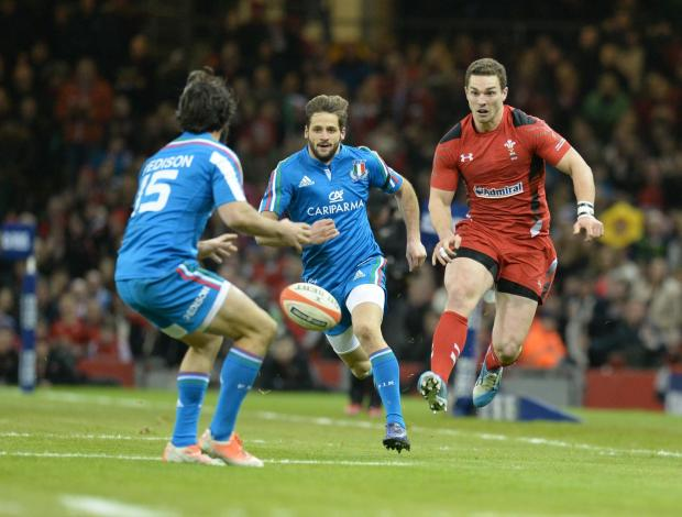 Penarth Times: KICKING ON: George North shows some ball skills to get past the Italian defence