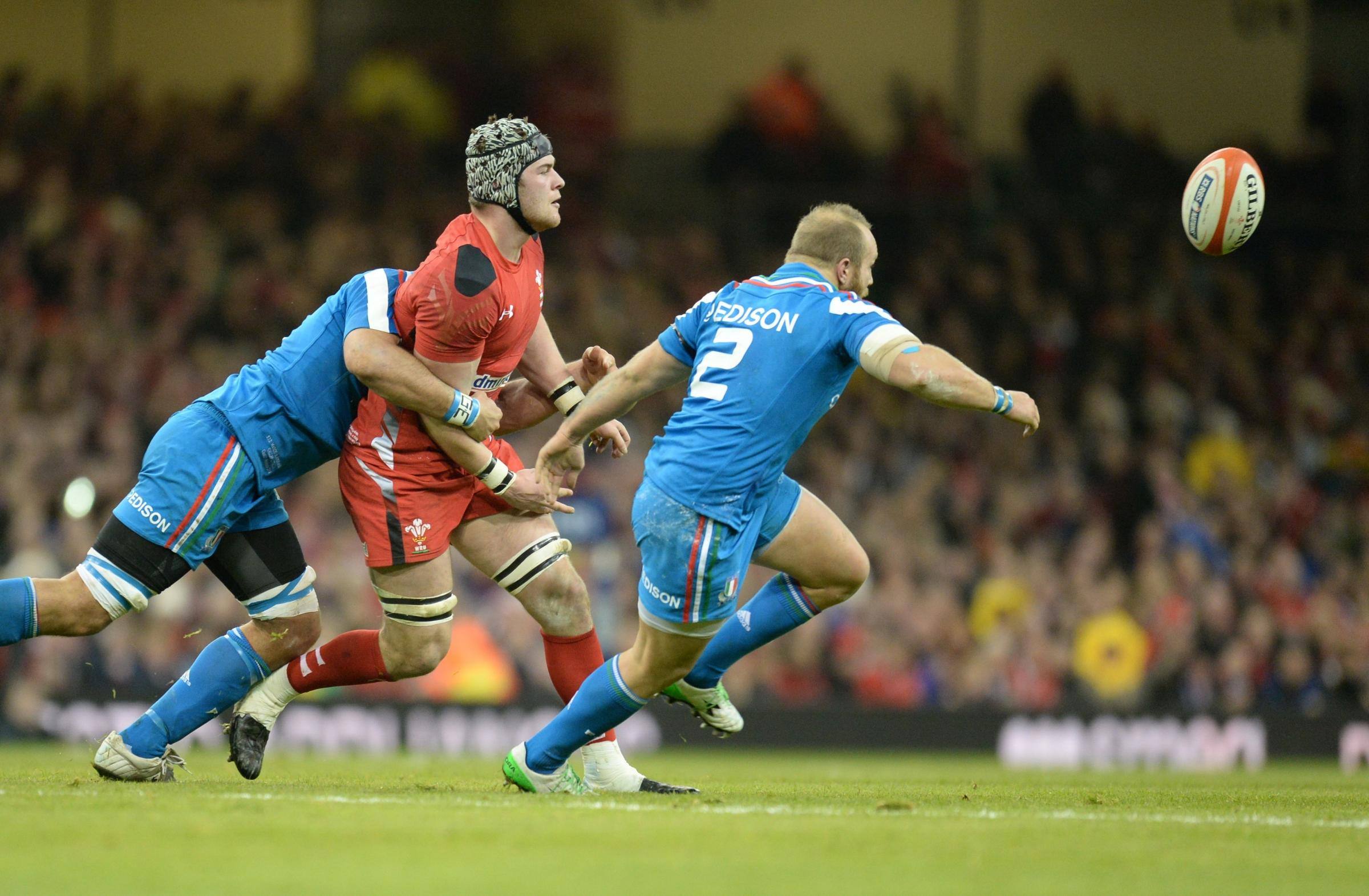 WINNING START: Wales' Dan Lydiate releases the ball under pressure against Italy
