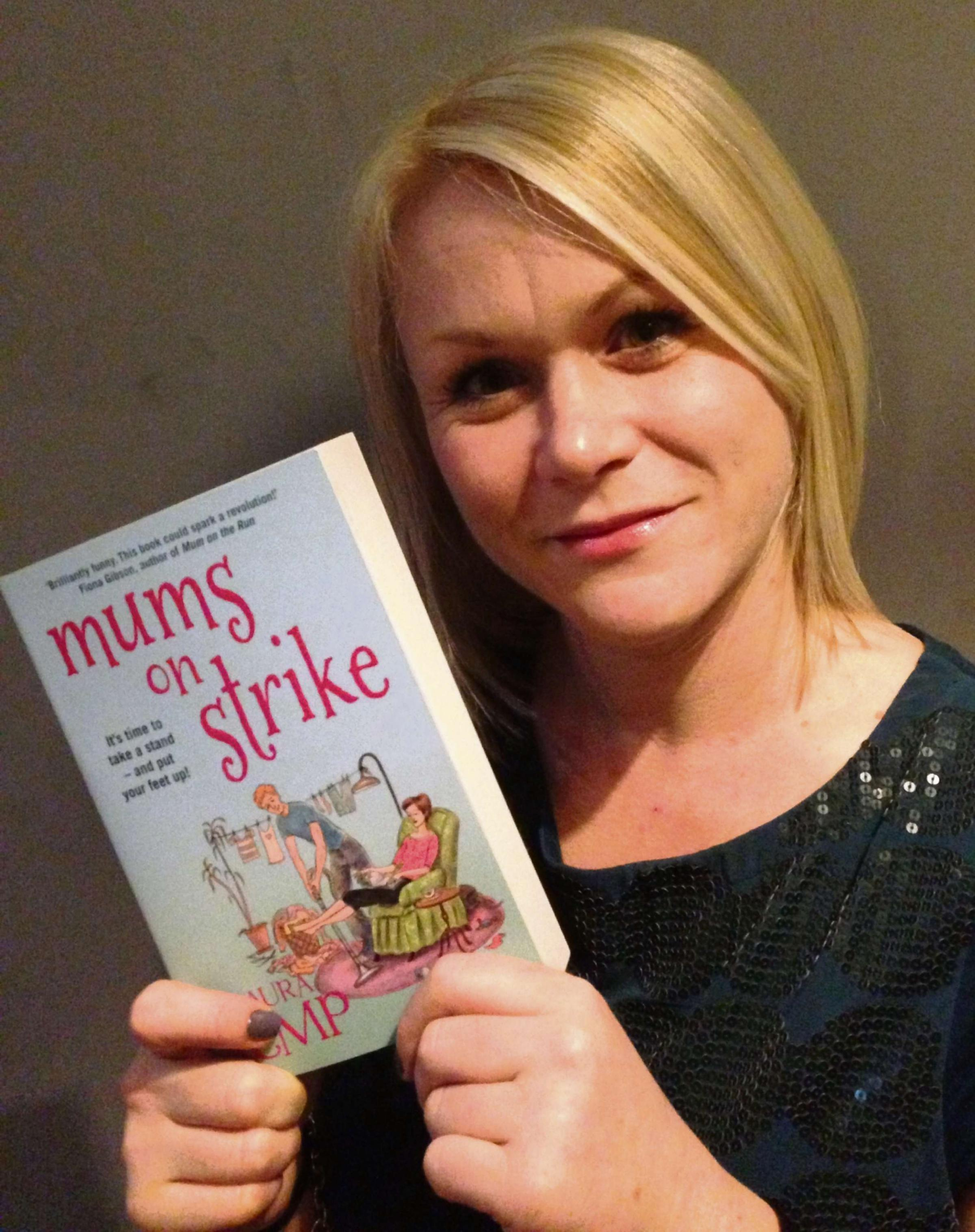 AUTHOR: Laura Kemp with her latest book 'Mums on Strike'