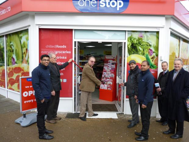REOPENING: Penarth Town Mayor Cllr Neil Thomas cut the red ribbon to reopen the One Stop shop