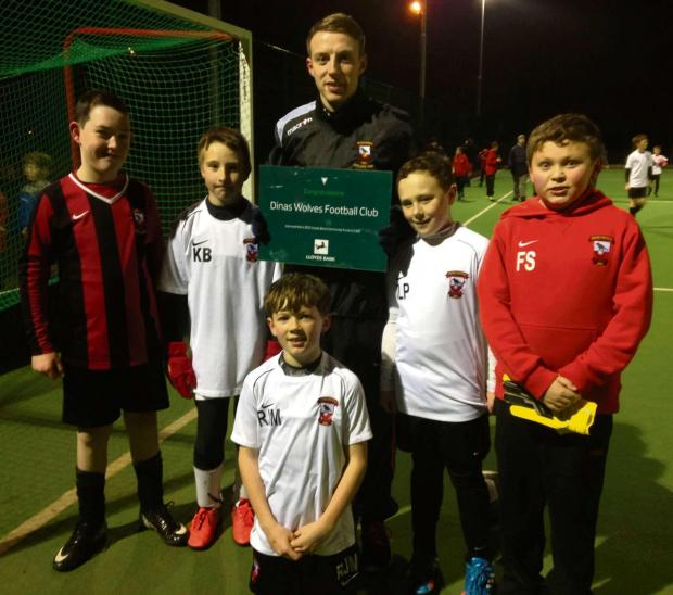 BANK BOOST: Coach Dan Jose and players from the Dinas Powys Wolves Football Club celebrate their award from the Lloyds Bank Community Fund.