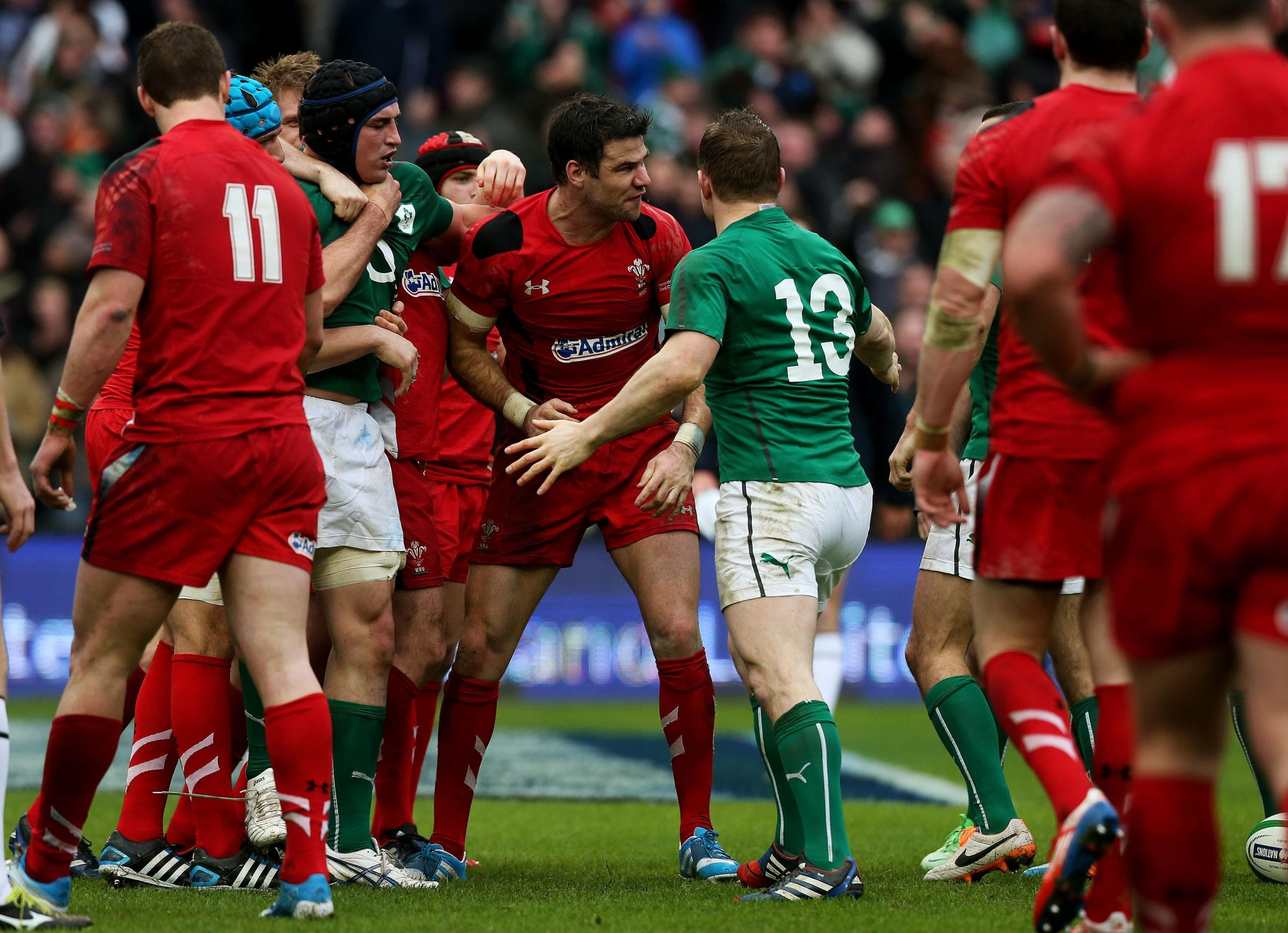 TRIED VALIANTLTY: Mike Phillips battled hard but was sin binned late in the game after this incident which errupted after Liam WIlliams struck Paddy Jackson following the Ireland player scoring his side's second try