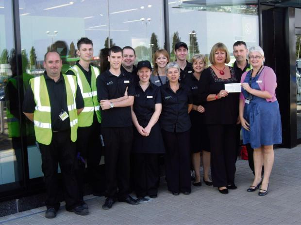 DONATION: Anna Morgan handing a cheque to Joanna thompson with Marks & Spencer staff. (3796117)