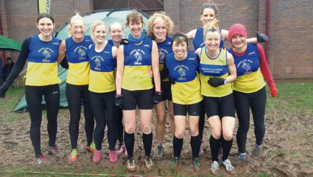 Penarth Times: BEFORE THE STORM: The women's team before they battled the elements in the Gwent League Brecon cross country race (3936281)