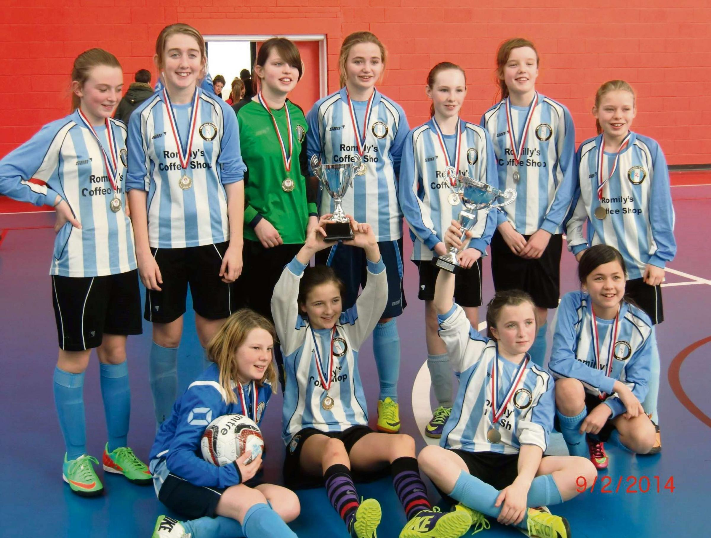 CUP WINNERS: In just their second season, an under-12 side has created a bit of history as the first Vale Ladies' & Girls' Football Club team to win a c