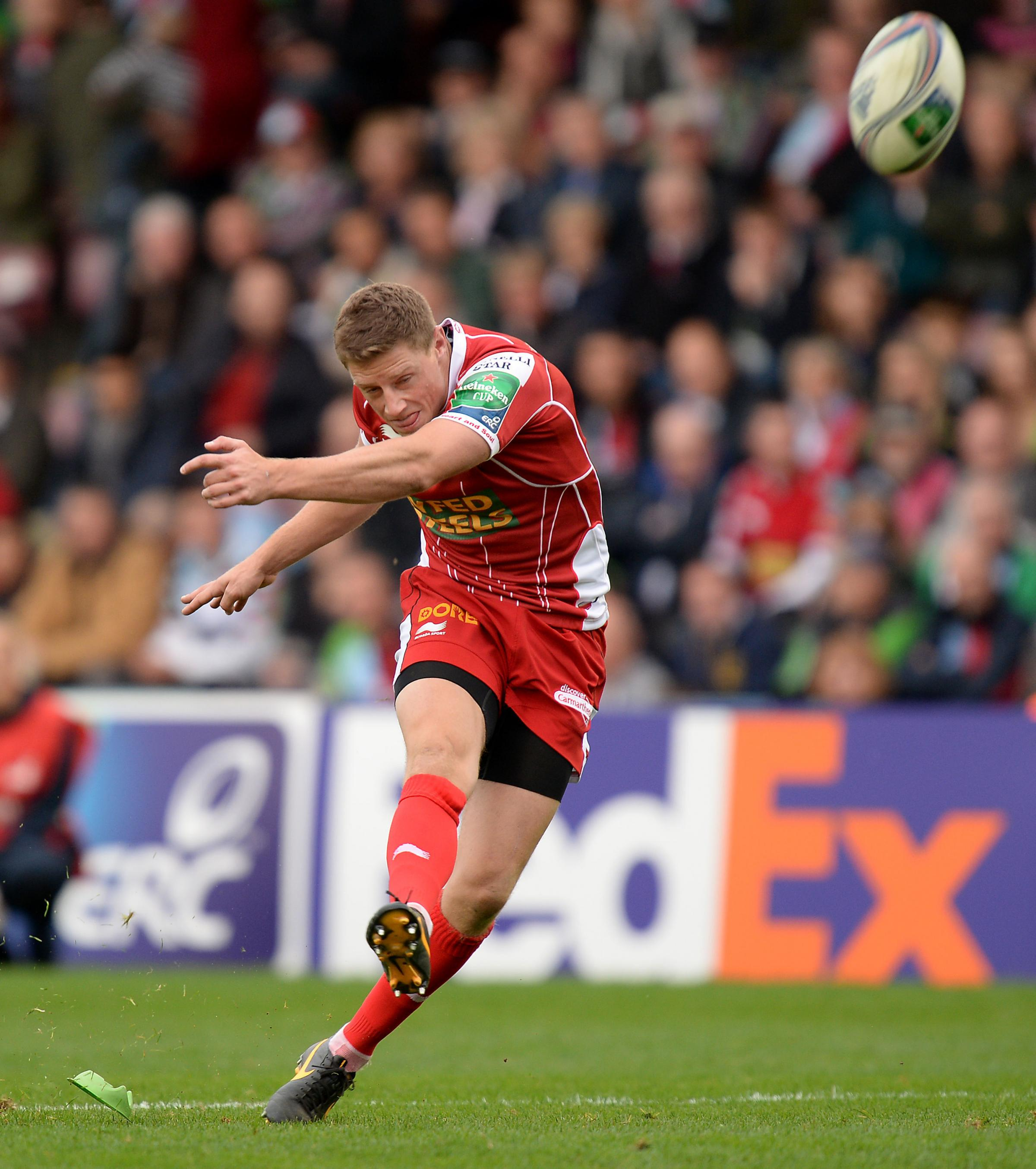 Scarlets' Rhys Priestland kicks a conversion during the Heineken Cup match at Twickenham Stoop, London. PRESS ASSOCIATION Photo. Picture date: Saturday October 12, 2013. See PA story RUGBYU Harlequins. Photo credit should read: Andrew Matthews/PA Wire