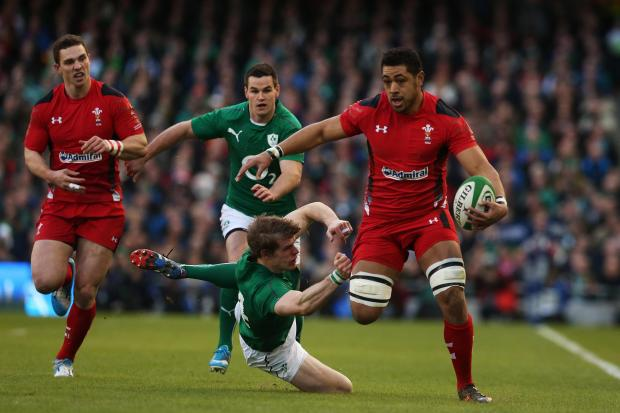 Wales' Taulupe Faletau is tackled by Ireland's Andrew Trimble during the RBS 6 Nations match at the Aviva Stadium, Dublin, Ireland. PRESS ASSOCIATION Photo. Picture date: Saturday February 8, 2014. See PA story RUGBYU Ireland. Photo credit should