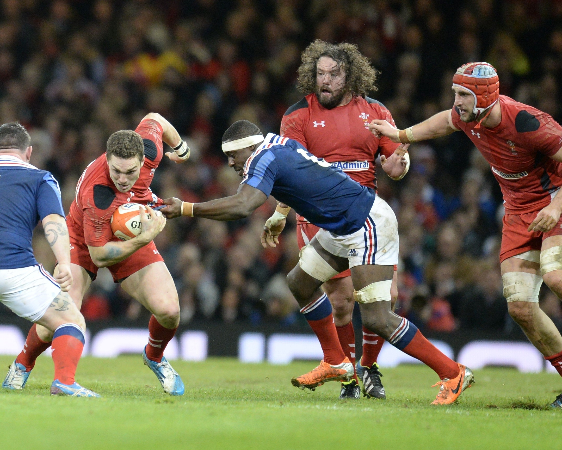 BIG WIN: Adam Jones, centre, watches on as George North goes for the gap against France