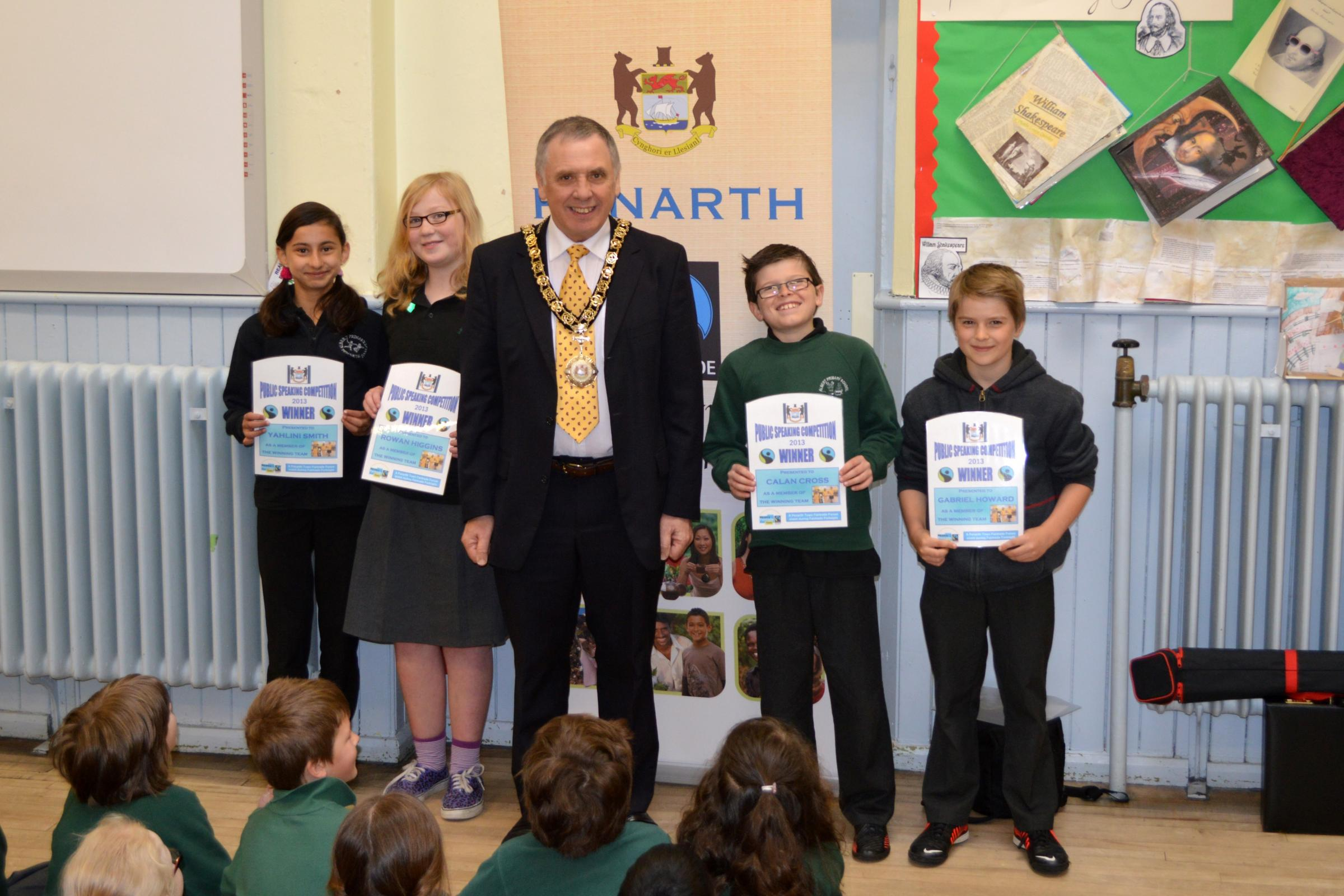 FAIRTRADE: Cllr Phil Rapier, last year's town mayor, presenting the child