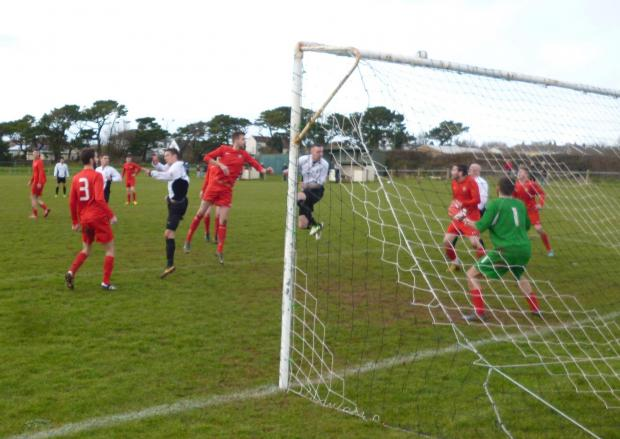 Penarth Times: HEMMENS HEADER: Sully Sports' Gareth Hemmens goes close with a header in Saturday's win over Fairwater.