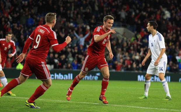 Penarth Times: EURO AIM: Wales midfielder Andy King celebrates his goal against Finland last time out