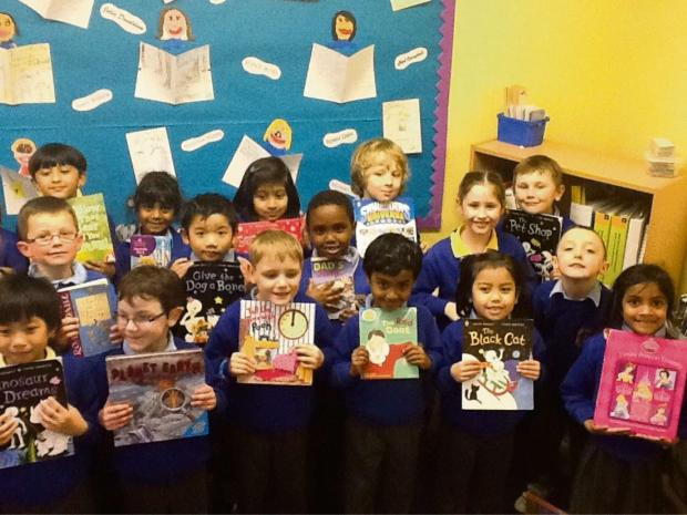 FUN: Llandough Primary School pupils with their favourite books. (4508637)