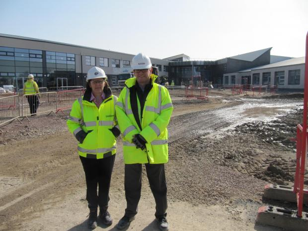 Penarth Times: NEW SCHOOL: Jane Wade, operations manager for property for the Vale Council, and Ron McLean, AECOM project manager, outside the new St Cyres at the Penarth Learning Community (4544647)