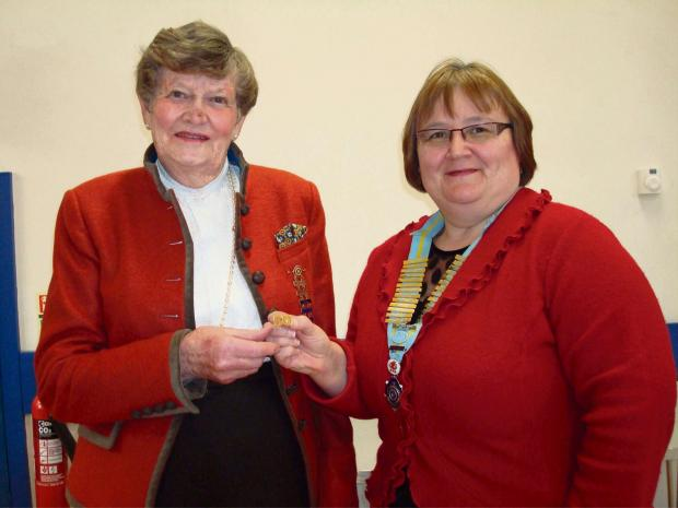 The district chairman of No 15 Inner Wheel District Karen Davies presents Molly Evans with a badge to mark her 50 years of service to Inner Wheel