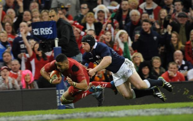 TRY: Toby Faletau crosses the line to score against Scotland. Picture: Mark Lewis