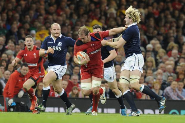 BATTLE: Alun Wyn Jones hands off Richie Gray. Picture: Mark Lewis