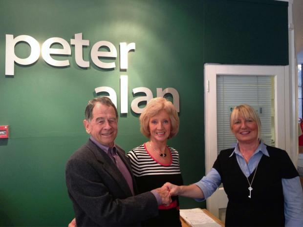 WINNERS: Alan and Lorna Sherriff with Debra Tuhey from Peter Alan estate agents