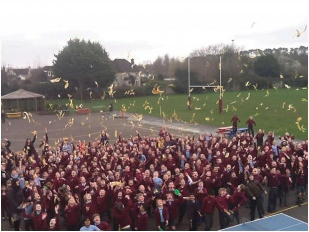 GO BANANAS! Evenlode Primary School pupils threw their banana skins in the air after enjoying their Fair Trade bananas