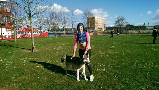 Penarth Times: RUNNER: Helen Griffiths with one of the dogs from Cardiff Dogs Home