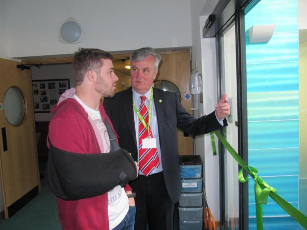 STANDING DOWN: Ray Hurcombe with Welsh rugby star Leigh Halfpenny  at the opening of a new hydrotherapy pool at Ty Hafan on Wednesday, March 26 (4905728)