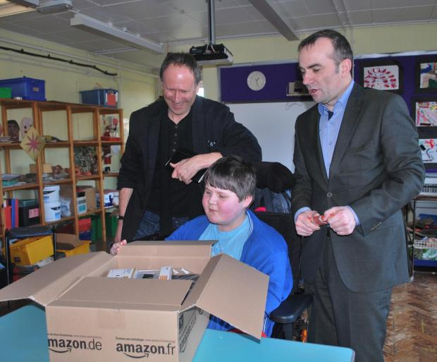 LAPTOP: Ysgol Erw'r Delyn pupil Lewis Gasson was given a laptop by HLM Architects and Loyn & Co Architects(4724359)