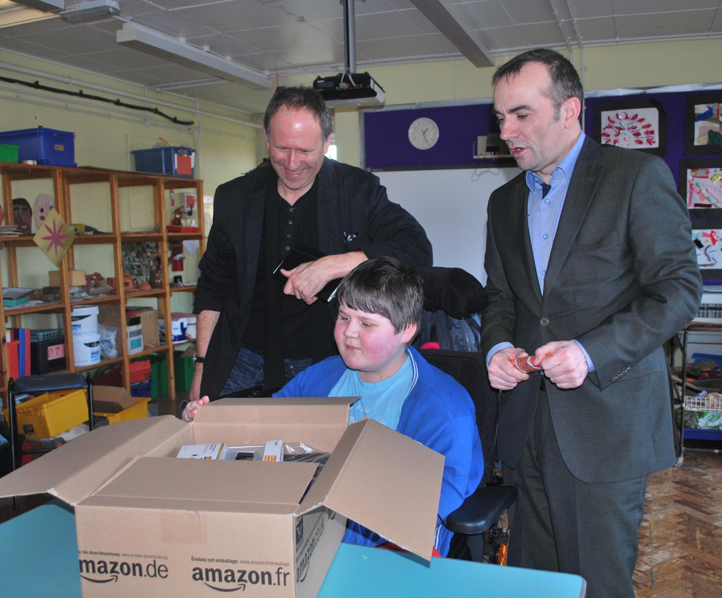 LAPTOP: Ysgol Erw'r Delyn pupil Lewis Gasson was given a laptop