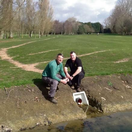 CELEBRATE: Mike Williams of Glamorganshire Golf Club and Jon Morgan of Keith Morgan Mowers inspecting the drainage on the sixth hole. (5015064)