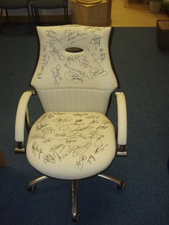 CHAIR: A leather chair signed by Liverpool and Everton players, including former Toffee Wayne Rooney, will be sold at the art sale