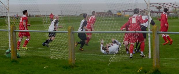 GOALMOUTH ACTION: Sully Sports camped in the Brecon goalmouth in Saturday's South Wales Senior Soccer League win at Swanbridge.