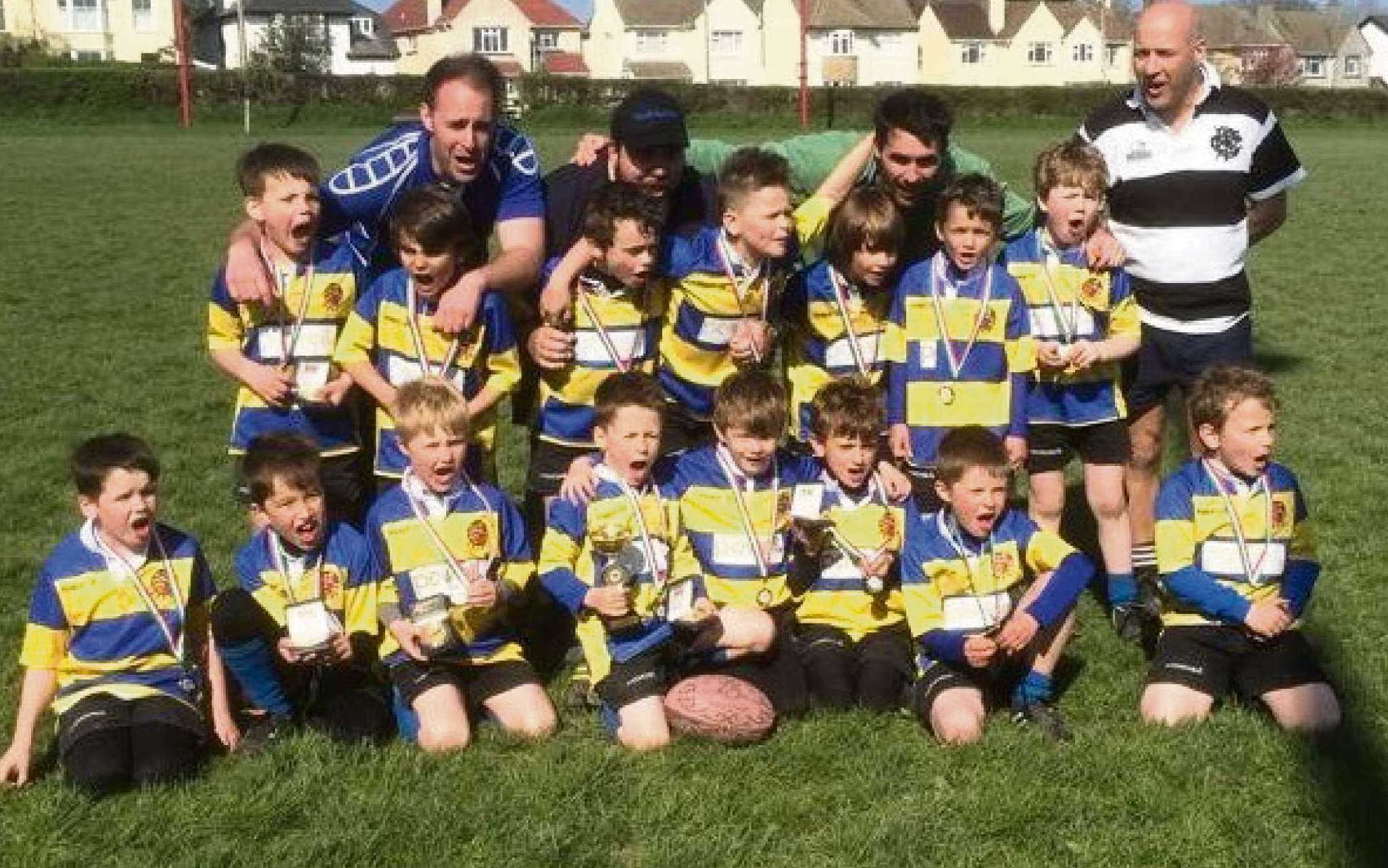 DOUBLE TRIUMPH: Some of the Old Penarthians' Titans and coaching team after the cup and plate victory  in the Cardiff and Vale U7s district tournament.