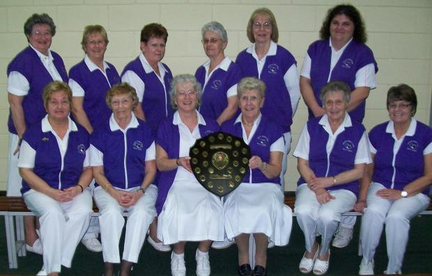 CHAMPIONSHIP SUCCESS: Ladies from the Sully Indoor Bowls Club with the D J Radford Championship League Shield - back row, from left: Barbara Stanton, Beryl Holmes, Linda Woodcock, Pat Cogbill, Pat Holsworthy and Bethan Horgan. Front: June Best, Myra Newma
