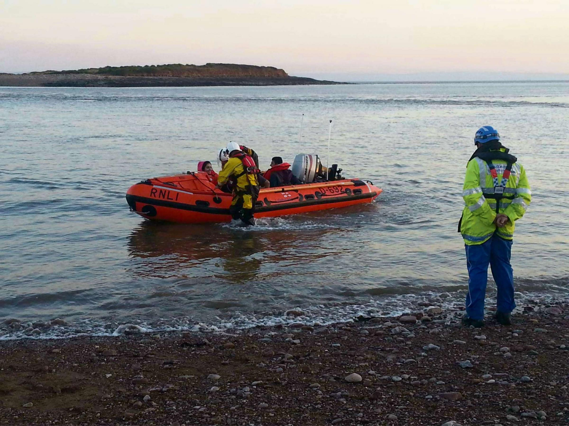Lifeboat and coastguards rescue stranded Sully Island family