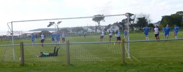 SPOT ON: Alex Long puts Sully Sports ahead from the penalty spot in Saturday's South Wales Senior Soccer League win over Pontlottyn..