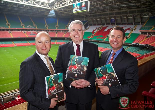 Penarth Times: BID TEAM: FAW chief executive Jonathan Ford, First Minister Carwyn Jones and WRU group chief executive  Roger Lewis