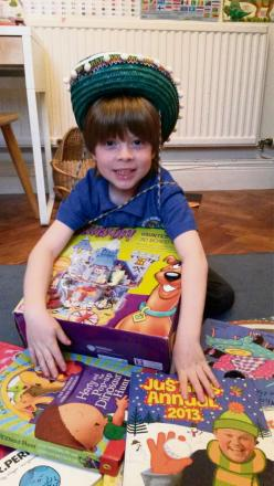 CHARITY DONATION: Robert Katchi sold his own toys to raise money for charity