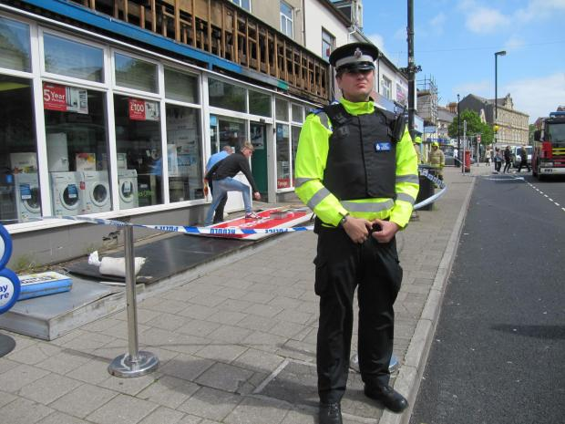 Penarth Times: SIGN FALLING: Police cordoned off the area where the shop sign fell