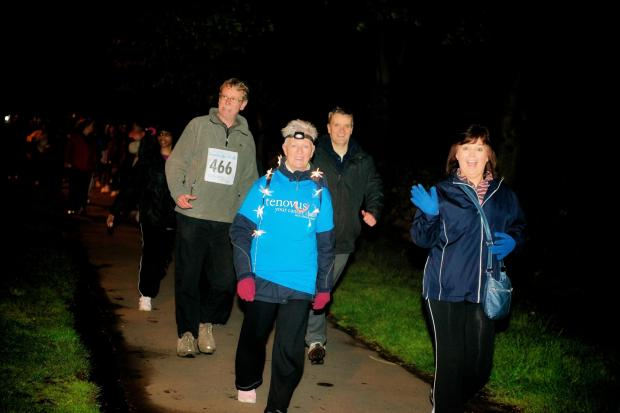 Penarth Times: CANCER CHARITY: Walkers raised more than £40,000 by taking part in last years Goodnight Walk