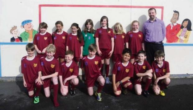 Penarth Times: FOOTBALL KIT: The Year 5/6 football team at Victoria Primary School in new kit provided by Mr Ovidijus Janeliauskas, of the Cefn Mably, Penarth.