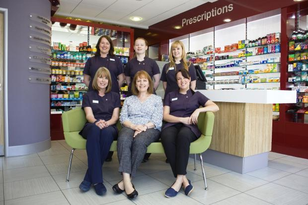 Penarth Times: WINNING TEAM: Jane Soltys (centre) with her team at Washington Pharmacy in Penarth.