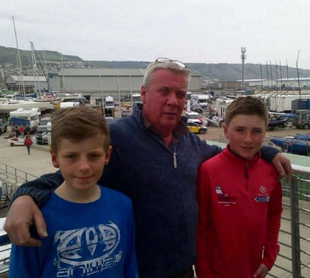 SAILING TO WORLDS: Cardiff Bay Yacht Club chief instructor Nick Sawyer with Optimist sailors William Hall, aged 13, and 12-year-old Rhys Lewis, of Penarth, who have been selected as part of a team to represent Great Britain at the World Championships in A
