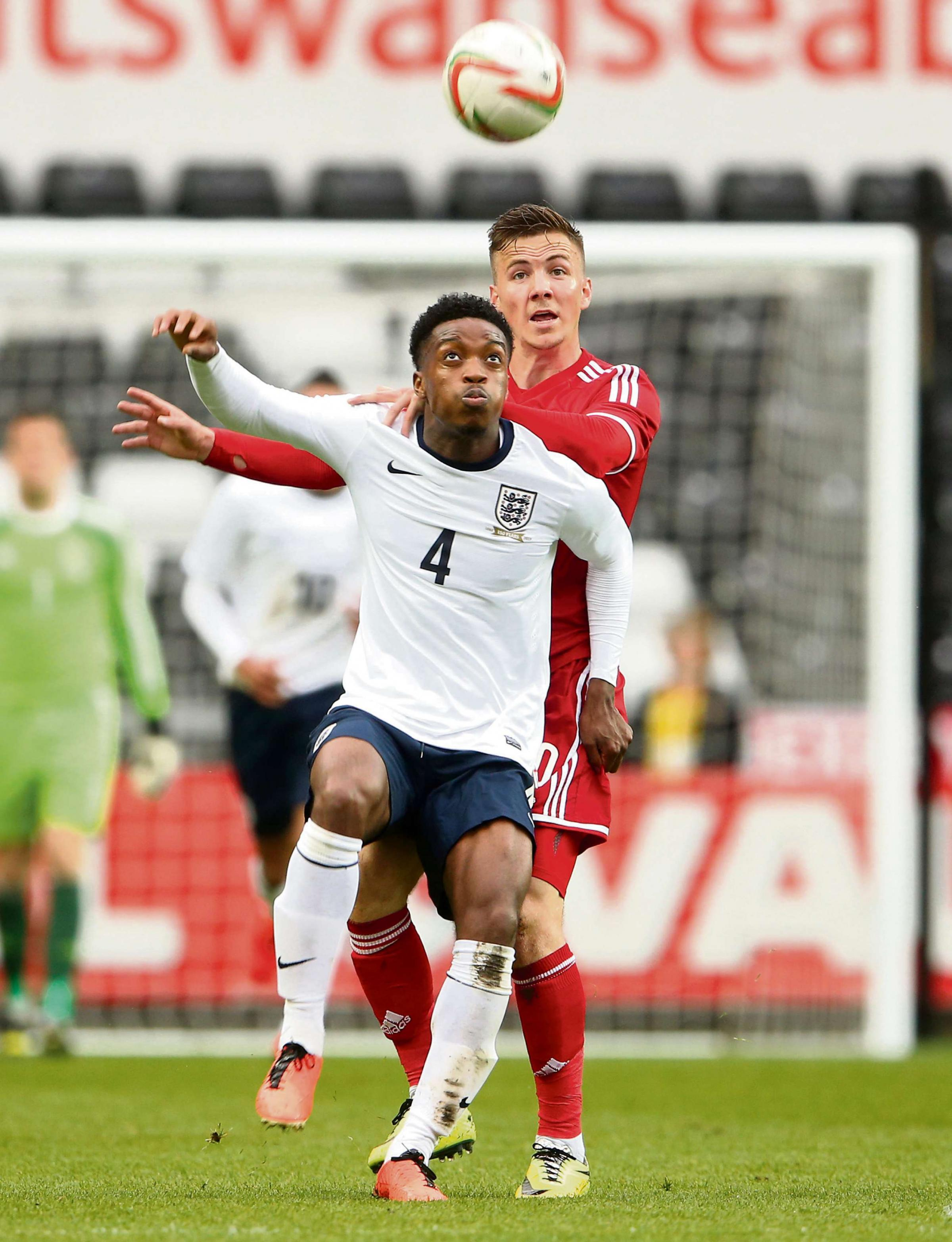 WAITING GAME: Lee Evans, right, in action for Wales under-21s against England