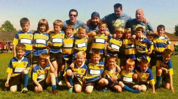 GREAT SEASON: Celebrating a great season after their final tournament at Cwmbran are the Old Penarthians Rugby Club U7s, coaches and the referee.