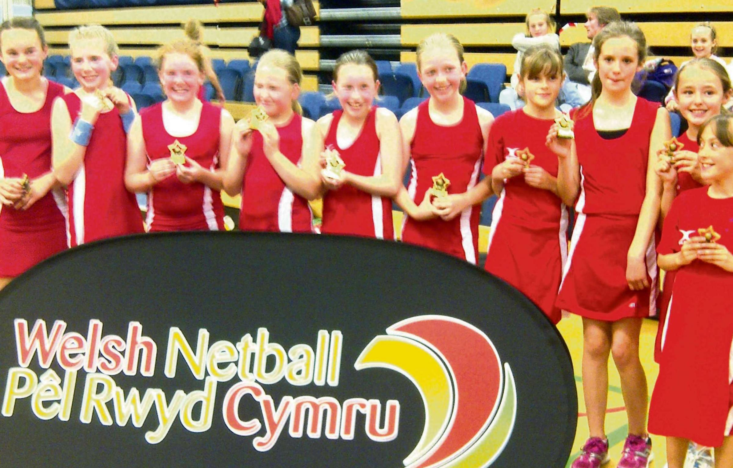 WINNING DRAGONS: Unbeaten at the Cardiff and Vale U11 Netball Championships, the Red Dragon Juniors - comprising girls from across the Vale -  won the Plate competition at the Welsh Clubs Championships.