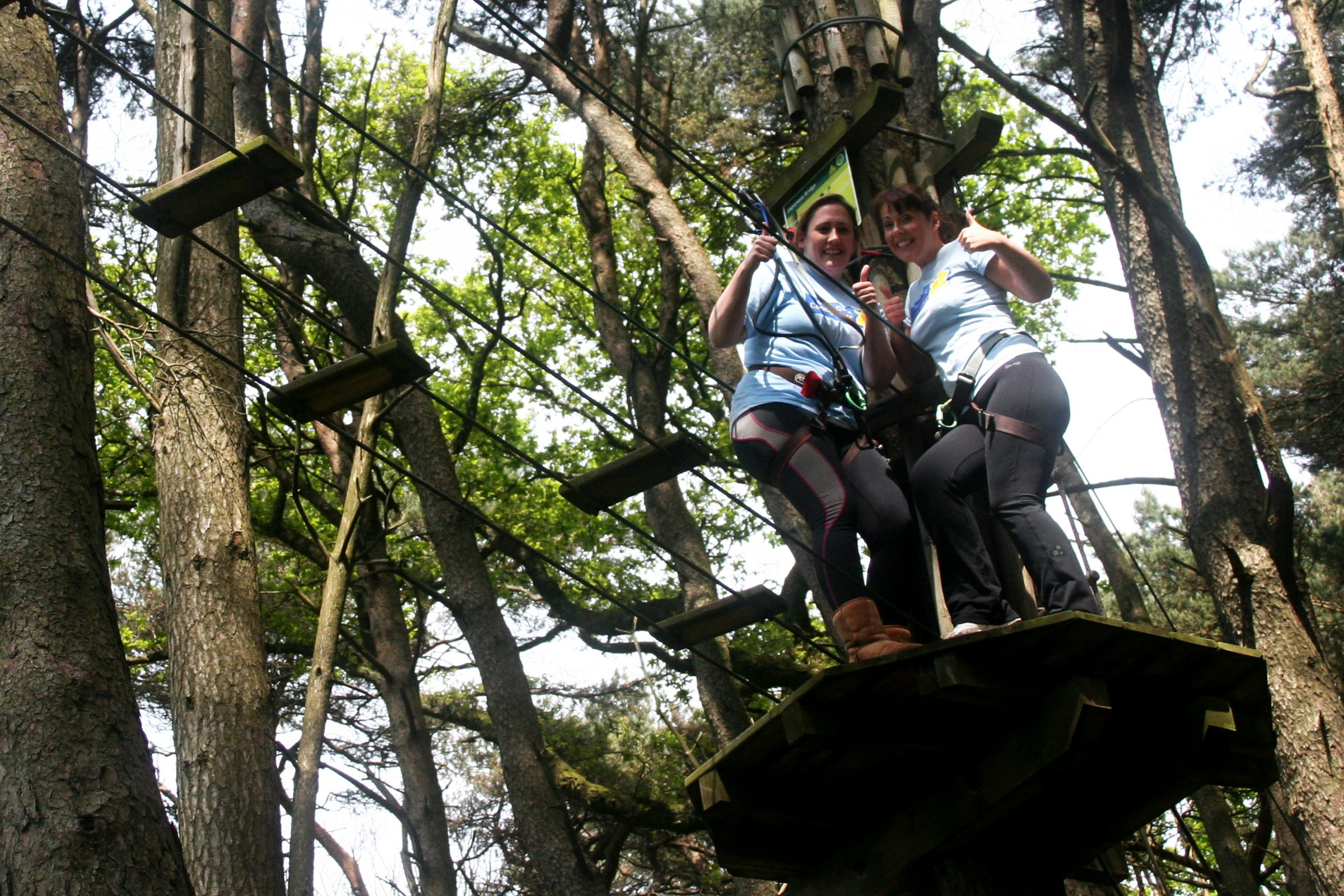 TREETOPS CHALLENGE: Helen Mulhern and Georgina Burke took to the tree tops at Go Ape in Margam Park