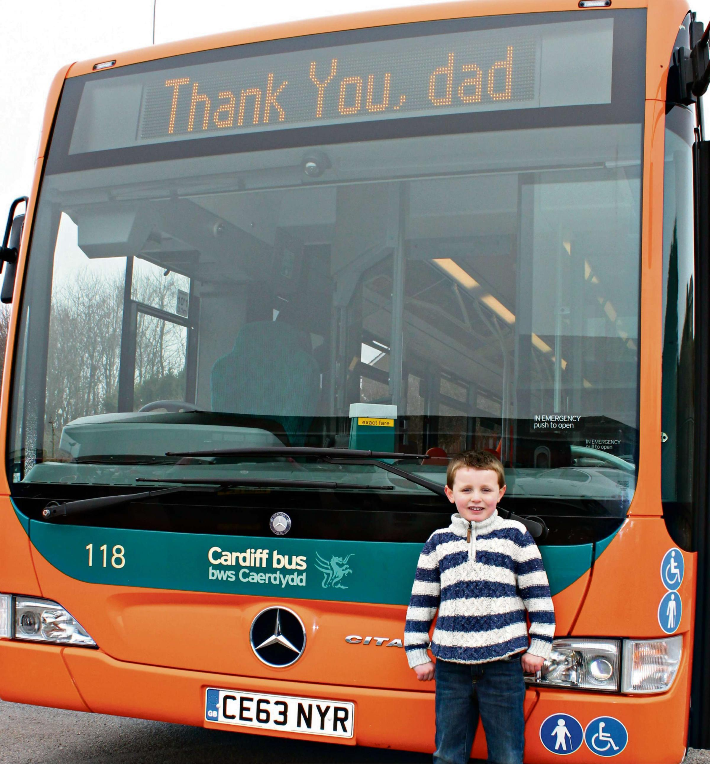 COMPETITION: Four-year-old Penarth schoolboy Alfie Morgan in front of a Cardiff Bus